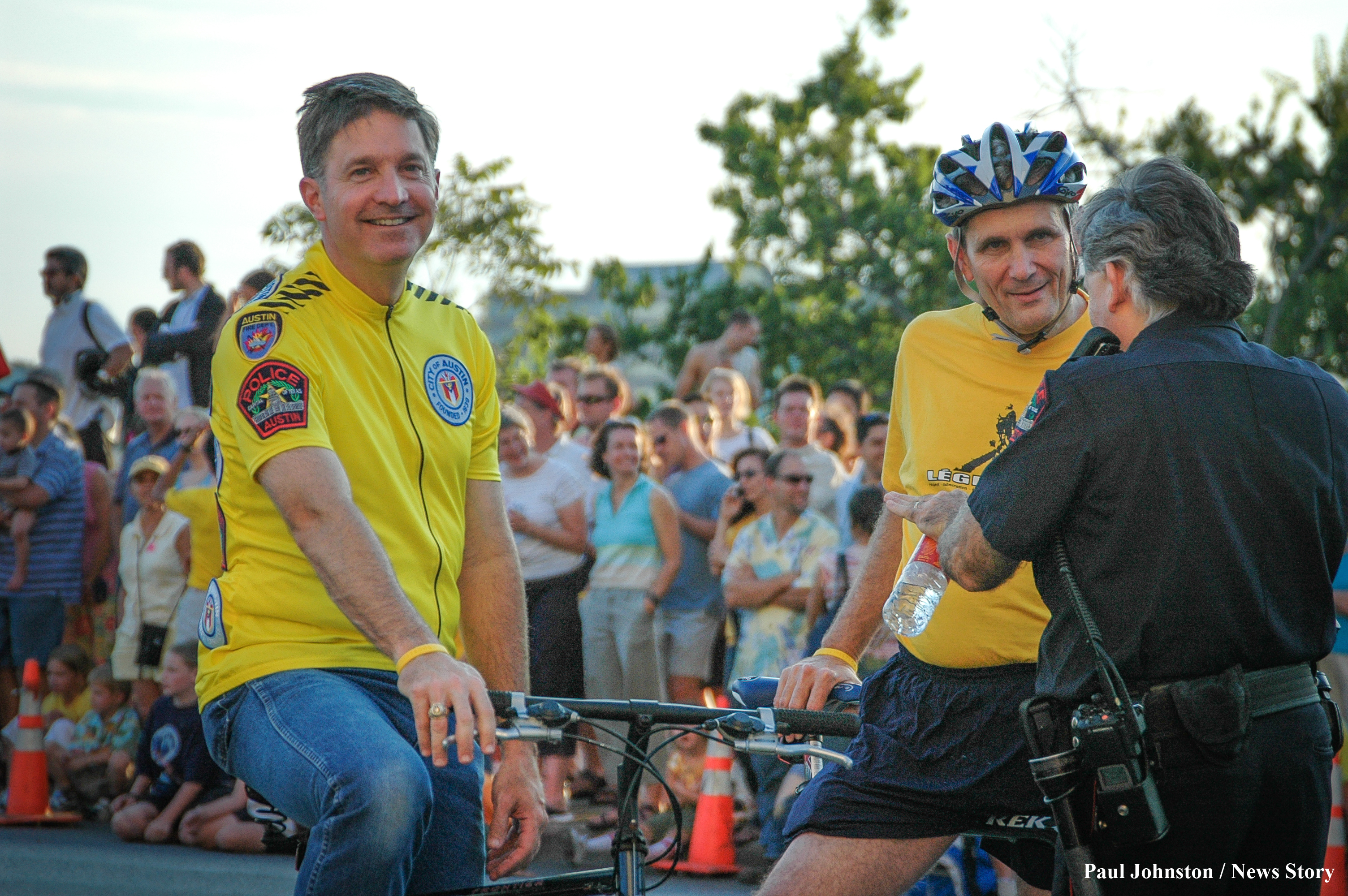 Austin Mayor Will Wynn (left) and Congressman Lloyd Doggett (right) participate in the bicycle parade in honor of Lance Armstrong on August 13, 2004 in Austin, Texas.  Copyright - Paul Johnston / Austin News Story - austinnewsstory.com